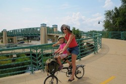 Bikabout founder Megan Ramey with daughter Annika in Madison, Wisc. [photo Kyle Ramey]