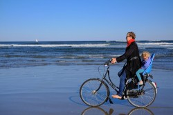 Bikabout founder Megan Ramey with daughter Annika Ramey on Plum Island, Mass. [photo Kyle Ramey]
