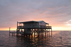 Stilt house at sunset